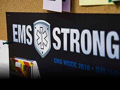 Poster with the words EMS STRONG written on it