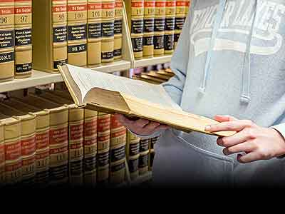 Student reading law book