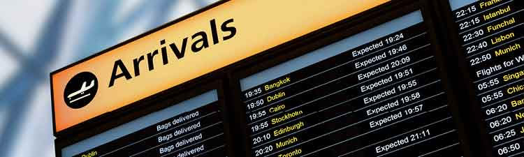 Airport arrivals sign listing arriving flights