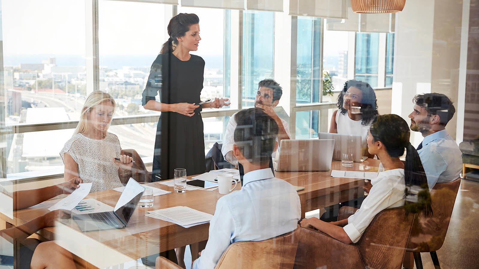 Orientation Session taking place at a conference room table